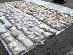 A haul of heroin that was hidden inside bags of rice seized from a container ship at the port of Felixstowe (National Crime Agency)