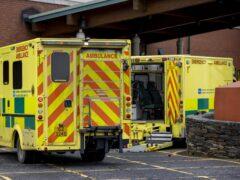 Ambulances queued at the entrance to a hospital (PA)
