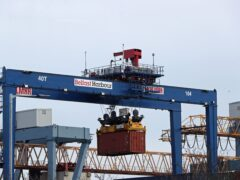 A cargo crate being moved at Belfast Port (PA)