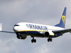 The competition watchdog has closed an investigation into Ryanair and British Airways over refunds (Niall Carson/PA)