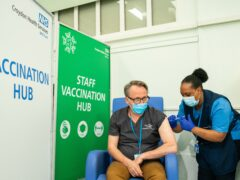 People receive a Covid-19 booster jab at Croydon University Hospital in south London (Dominic Lipinski/PA)