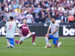 Manchester United's Cristiano Ronaldo (left), Bruno Fernandes (right) and West Ham's Declan Rice take a knee prior ahead of their Premier League match in September (Mike Egerton/PA).