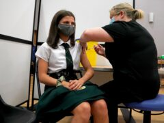 Children aged 12 to 15 in England can now book Covid-19 jabs at existing vaccination centres (Andrew Milligan/PA)