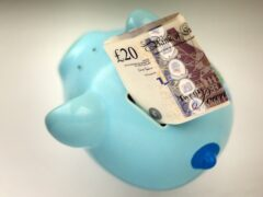 Money in a piggy bank (Gareth Fuller/PA)