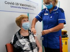 Margaret Keenan, the first person to receive the coronavirus vaccine in December last year, receives her booster jab at University Hospital Coventry, Warwickshire (Jacob King/PA)