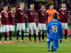 Glen Kamara kneels before the start of the Europa League Group A soccer match between Sparta Prague and Rangers (Petr David Josek/AP)