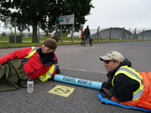 Extinction Rebellion activists protest outside Farnborough Airport in Hampshire (Andrew Matthews/PA)