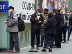 People queue to receive a Covid-19 jab at a pop-up vaccination centre at Westfield Stratford City shopping centre in east London (Kirsty O'Connor/PA)
