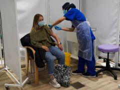 A person receives a Covid-19 jab at a pop-up vaccination centre at Westfield Stratford City (Kirsty O'Connor/PA)