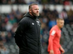 Wayne Rooney oversaw a goalless draw against Swansea (Barrington Coombs/PA)
