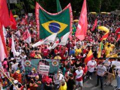 Demonstrators join a protest against Brazilian President Jair Bolsonaro (Andre Penner/AP)