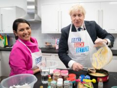 Home Secretary Priti Patel and Prime Minister Boris Johnson visited HideOut Youth Zone in Manchester (Stefan Rousseau/PA)