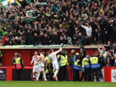 Celtic players and fans celebrate a long-awaited away win (Andrew Milligan/PA)