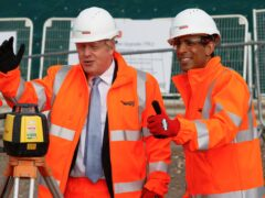 Prime Minister Boris Johnson and Chancellor Rishi Sunak joked about 'levelling up' during a Network Rail site visit in Manchester (Phil Noble/PA)