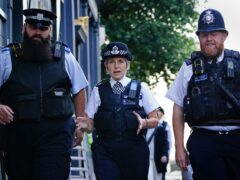 Metropolitan Police Commissioner Dame Cressida Dick alongside police officers during a walkabout in Westminster (Victoria Jones/PA)