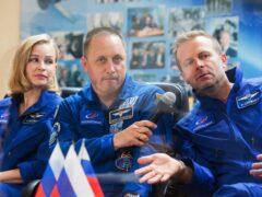 Actress Yulia Peresild, director Klim Shipenko, right, and cosmonaut Anton Shkaplerov (Roscosmos Space Agency via AP)