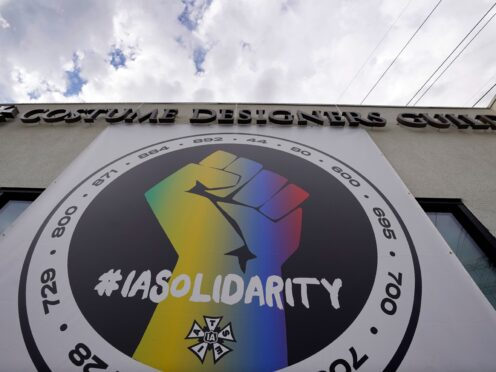 A poster advocates union solidarity (Chris Pizzello/AP)