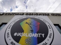 A poster advocating union solidarity hangs from a Costume Designers Guild office in Burbank, California (Chris Pizzello/AP)
