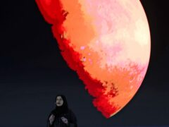FILE – In this Feb. 9, 2021 file photo, Sarah Al Amiri, Emirati Minister of State for Advanced Sciences and Deputy Project Manager of the Emirates Mars Mission speaks ahead of a live broadcast of the Hope Probe as it attempts to enter Mars orbit as a part of Emirates Mars mission, in Dubai, United Arab Emirates. The United Arab Emirates on Tuesday, Oct. 5, 2021, announced plans to send a probe to land on an asteroid between Mars and Jupiter to collect data on the origins of the universe, the latest project in the oil-rich federation's ambitious space program. (AP Photo/Kamran Jebreili, File)