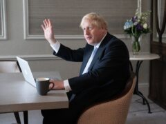 Prime Minister Boris Johnson prepares his keynote speech in his hotel room in Manchester before addressing the Conservative Party conference on Wednesday (Stefan Rousseau/PA)