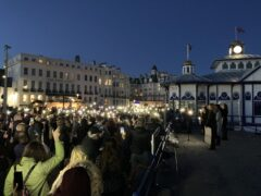 People at a vigil for Sabina Nessa at Eastbourne Pier (Michael Drummond/PA)