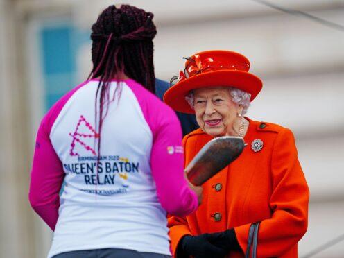 The Queen handed the baton to Paralympic champion Kadeena Cox (Victoria Jones/PA)