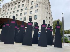 Silhouettes representing 16 women who have been killed by serving or former police officers since 2009 (Sophie Wingate/PA)