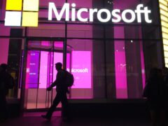 People walk past a Microsoft office in New York (Swayne B Hall/AP)