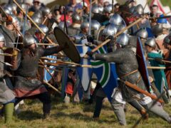 A clash during the Battle of Hastings re-enactment at Battle Abbey in Sussex (PA)