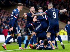 Scotland's Scott McTominay celebrates with his team-mates (Jane Barlow/PA)