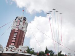 Thunder Tiger Aerobatics Team fly over Taipei during Taiwan's National Day celebrations (Chiang Ying-ying/AP)