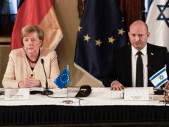 German Chancellor Angela Merkel attends a cabinet meeting with Israeli Prime Minister Naftali Benett in Jerusalem (Menahem Kahana/Pool/AP)