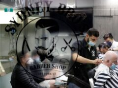 A Sydney barber shop clips and snips some of their first costumers in months after more than 100 days of lockdown on Monday (Rick Rycroft/AP)