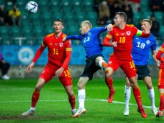 Kieffer Moore, left, poked home Wales' winner against Estonia after Aaron Ramsey was denied by a goal line clearance (Raul Mee/AP))