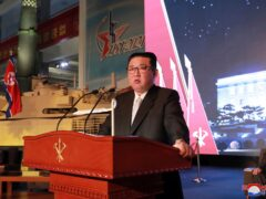 North Korean leader Kim Jong Un speaks during an exhibition of weapons systems in Pyongyang (Korean Central News Agency/Korea News Service/AP)