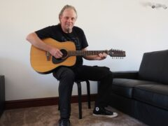 Mark Barrett, nephew of Syd Barrett, with the guitar once owned by the Pink Floyd founder member (Chris Parnham/PA)