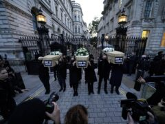 Campaigners carry coffins outside Downing Street in Westminster (Aaron Chown/PA)
