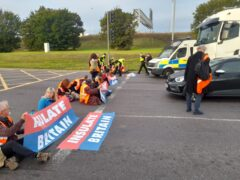 Insulate Britain protesters blocking the M25 at junction 31, near to the Dartford Crossing in Thurrock earlier this month (Insulate Britain/PA)