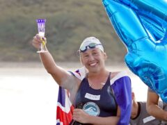 Australian endurance swimmer Chloe McCardel raises as glass after completing her 44th swim across the English Channel (Gareth Fuller/PA)