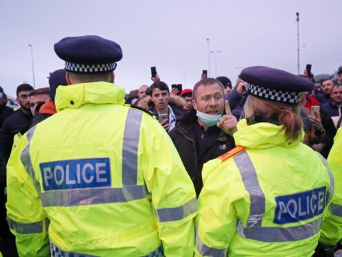 Police holding back drivers trying to enter the Port of Dover in Kent (Steve Parsons/PA)