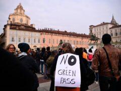 People stage a No Green Pass protest in Turin (Marco Alpozzi/LaPresse via AP)