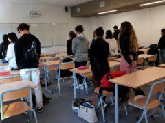 Students of Rene Cassin high school observe a minute's silence (Bob Edme/AP)
