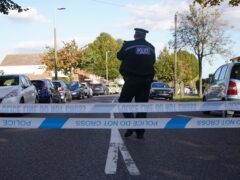 A police officer at the scene near the Belfairs Methodist Church in Eastwood Road North, Leigh-on-Sea, Essex, where Conservative MP Sir David Amess has died after he was stabbed several times at a constituency surgery. A man has been arrested and officers are not looking for anyone else. Picture date: Friday October 15, 2021.