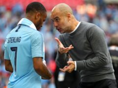 Pep Guardiola, right, has backed Raheem Sterling, left, to rediscover his best (Nick Potts/PA)