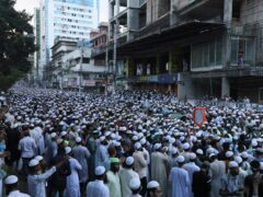 Muslims participate in a protest over an alleged insult to Islam, outside the country's main Baitul Mukarram Mosque in Dhaka, Bangladesh (Abdul Goni/AP)