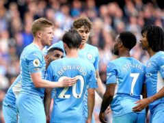 Manchester City's Kevin De Bruyne, left, celebrates with his team-mates (Martin Rickett/PA)