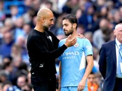 Manchester City manager Pep Guardiola speaks to Bernardo Silva at the end of the match (Martin Rickett/PA)