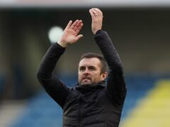 Luton Town's manager Nathan Jones applauds the fans after the Sky Bet Championship match at The Den, London. Picture date: Saturday October 16, 2021.