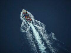 Migrants on an overcrowded wooden boat in the Mediterranean Sea (Renata Brito/AP)