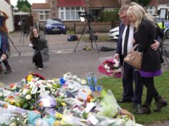 MP Mark Francois lays flowers at the scene near Belfairs Methodist Church in Eastwood Road North, Leigh-on-Sea, Essex (Kirsty O'Connor/PA)